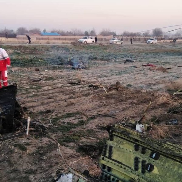 Investigators respond after a Ukrainian plane carrying at least 170 people crashed outside Tehran, Iran, on Jan. 8, 2020. (Credit: IRNA via CNN)