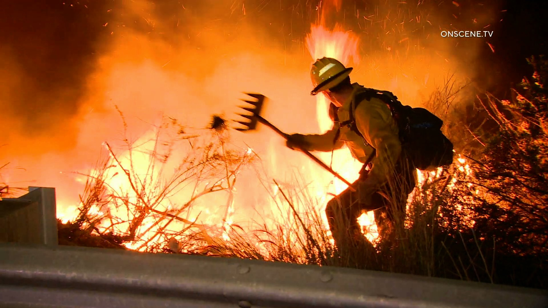 Crews work to extinguish a fire burning along the 5 Freeway in the San Clemente area on Jan. 29, 2020. (Credit: OnScene.TV)