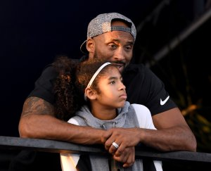 Kobe Bryant and daughter Gianna Bryant watch the Phillips 66 National Swimming Championships at the Woollett Aquatics Center on July 26, 2018, in Irvine. (Photo by Harry How/Getty Images)