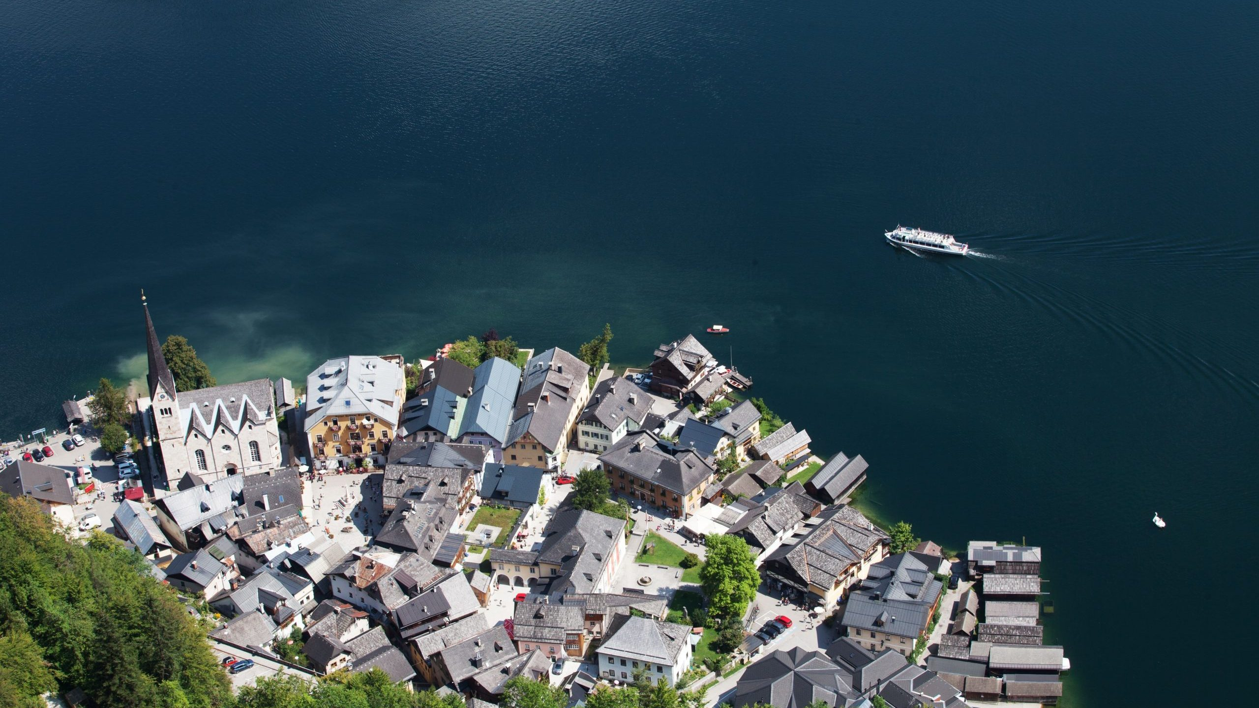 A picture taken from a suspended platform above the Hallstatt Lake shows an overview of Hallstatt, at the world heritage salt-mine in Hallstatt, Austria, on Aug. 16, 2018. (Credit: Alex Halada/AFP via Getty Images)
