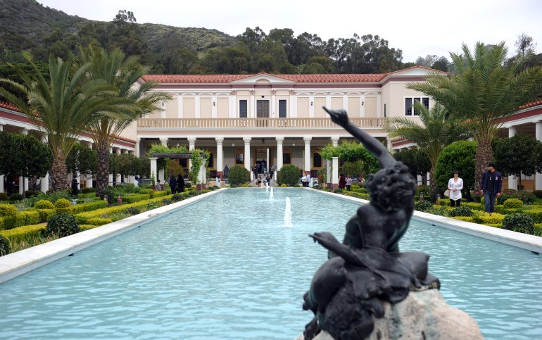 Visitors enjoy the garden at the Getty Villa Museum in Malibu on April 18, 2011. (Credit: GABRIEL BOUYS/AFP via Getty Images)
