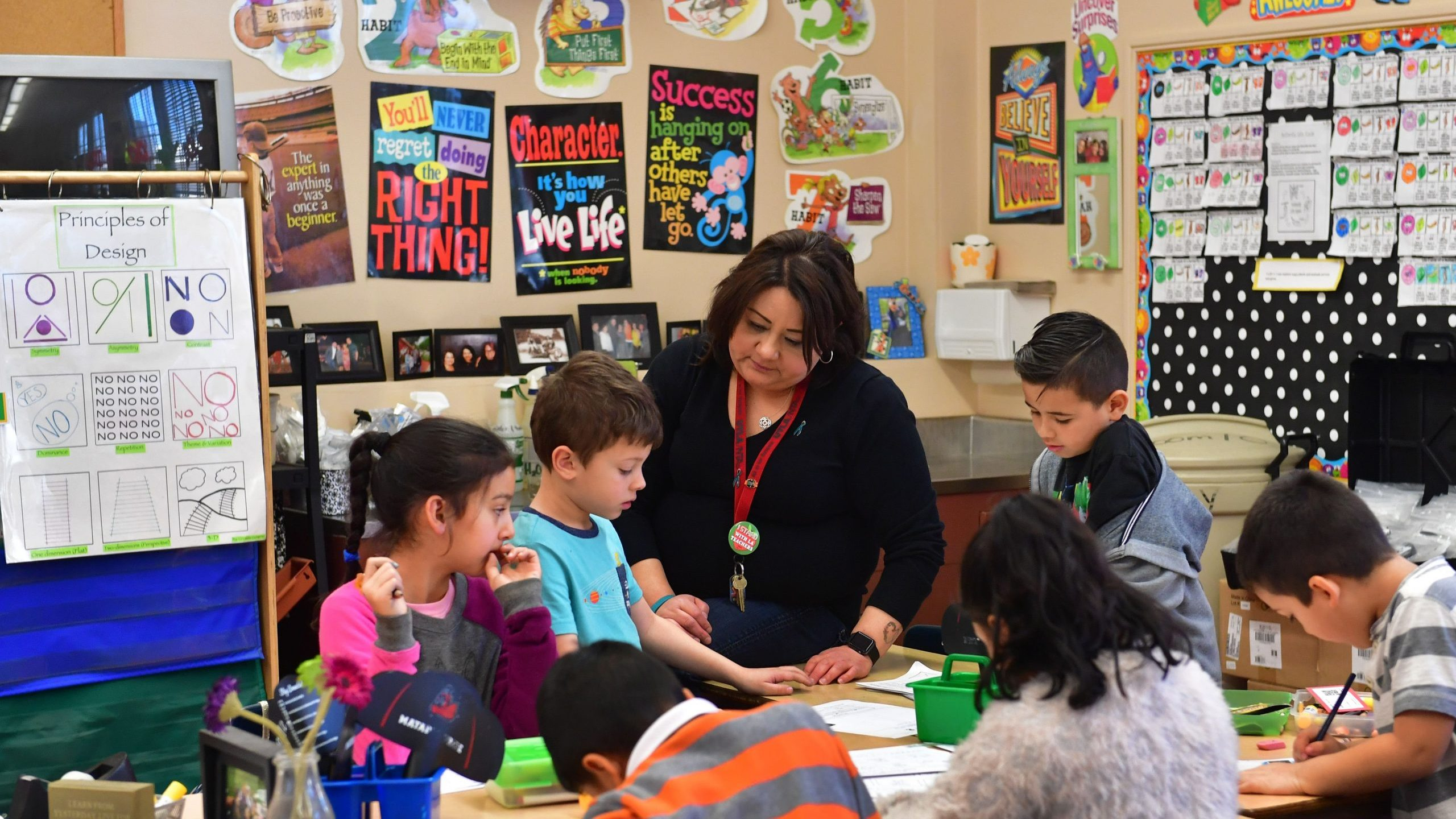 A Telfair Elementary School first grade teacher works with her students on Feb. 8, 2019, in Pacoima, California. (Credit: Frederic J. Brown/AFP via Getty Images)