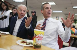 Former Vice President and Democratic presidential candidate Joe Biden eats at a King Taco restaurant with Los Angeles Mayor Eric Garcetti on May 8, 2019. (Credit: Mario Tama/Getty Images)