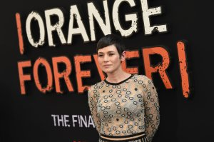 """Yael Stone attends the """"Orange Is the New Black"""" final season premiere at Alice Tully Hall, Lincoln Center on July 25, 2019 in New York City. (Credit: Dimitrios Kambouris/Getty Images)"""