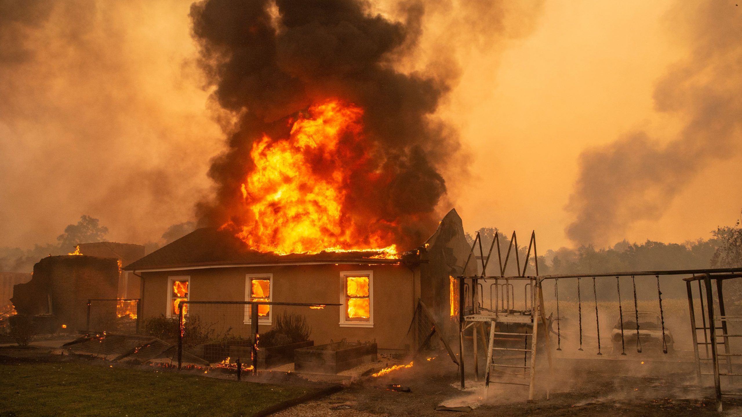 A home burns at a vineyard near Geyserville during the Kincade Fire on Oct. 24, 2019. (Credit: Josh Edelson / AFP / Getty Images)