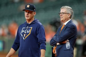 Manager AJ Hinch talks with Jeff Luhnow, General Manager of the Houston Astros, prior to game two of the American League Division Series against the Tampa Bay Rays at Minute Maid Park on Oct. 5, 2019 in Houston.(Credit: Bob Levey/Getty Images)