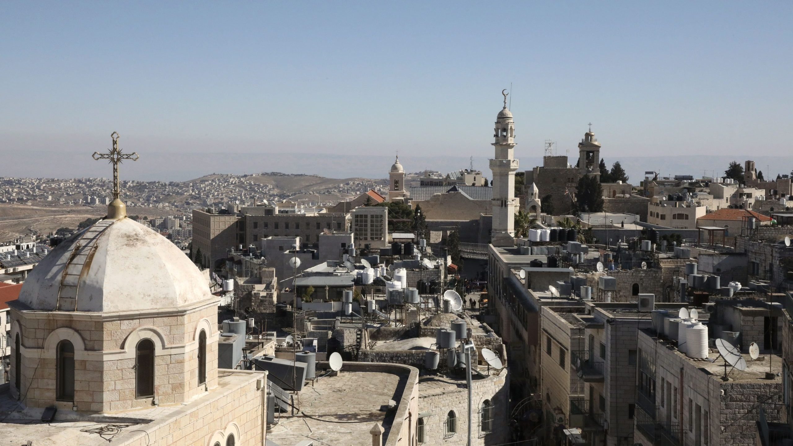 A general view of the West Bank biblical city of Bethlehem on Dec. 19, 2019, shows the minaret of a mosque and the Church of the Nativity, top right, the site where Christians believe Jesus was born. (Credit: HAZEM BADER/AFP via Getty Images)