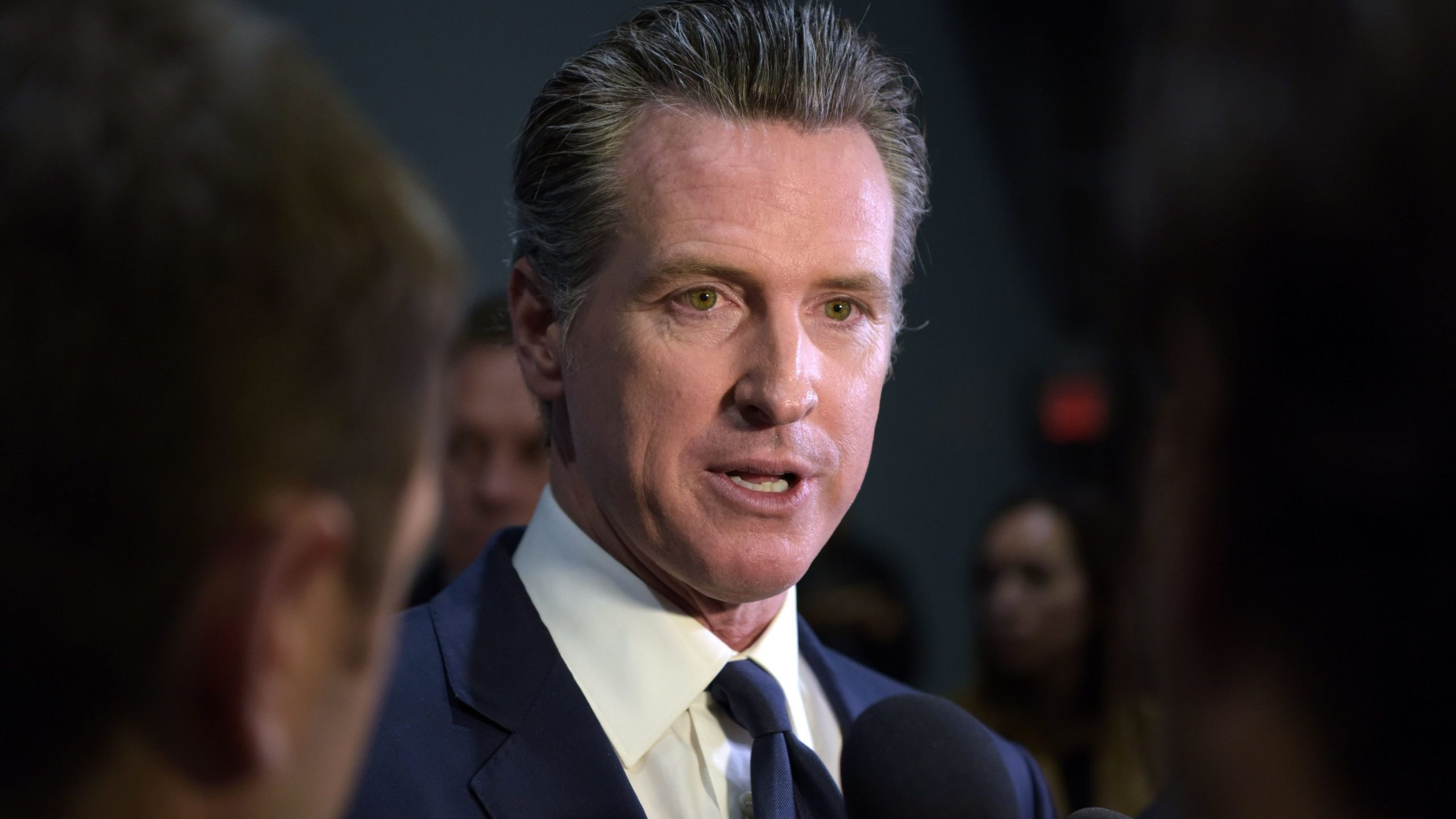 Gov. Gavin Newsom speaks to the press after the sixth Democratic primary debate of the 2020 presidential campaign at Loyola Marymount University in Los Angeles on Dec. 19, 2019. (Credit: AGUSTIN PAULLIER/AFP via Getty Images)