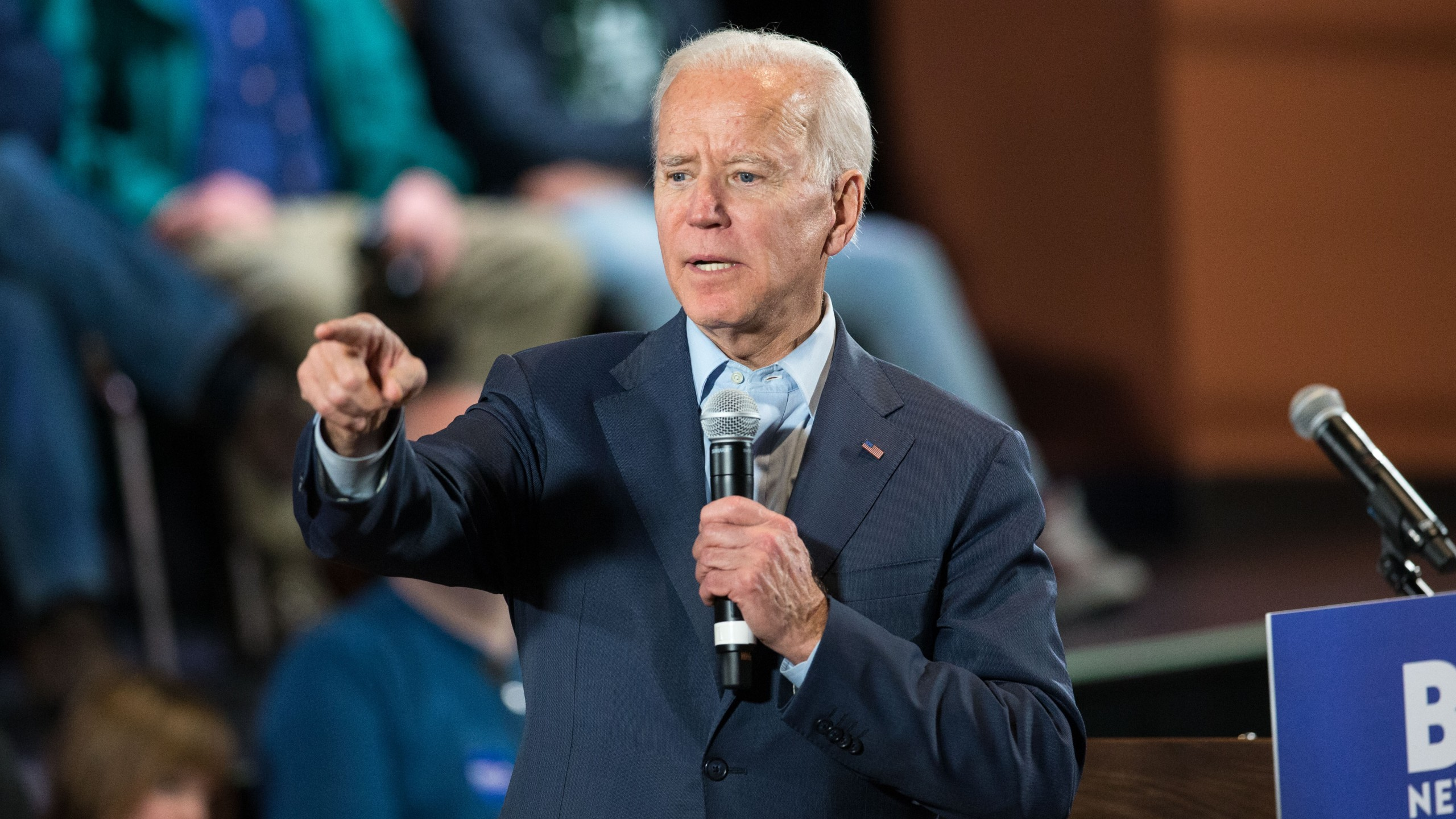 Democratic presidential candidate, former Vice President Joe Biden points to a member of the crowd who wanted to ask a question during a campaign Town Hall on Dec. 30, 2019 in Derry, New Hampshire. (Credit: Scott Eisen/Getty Images)