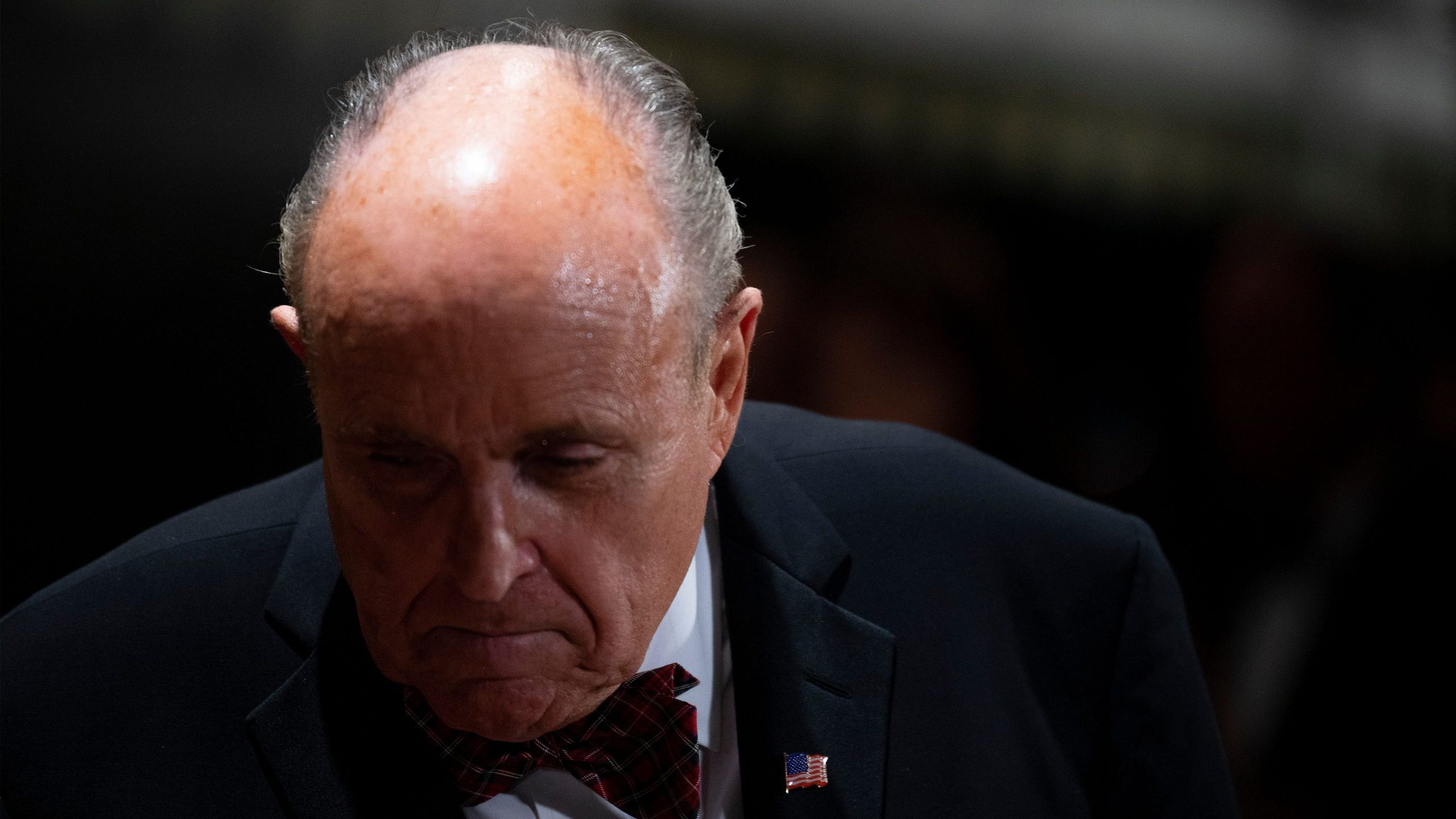 Donald Trump's personal lawyer Rudy Giuliani arrives for a New Year's celebration at Mar-a-Lago in Palm Beach, Florida, on Dec. 31, 2019. (Credit: Jim Watson/AFP via Getty Images)