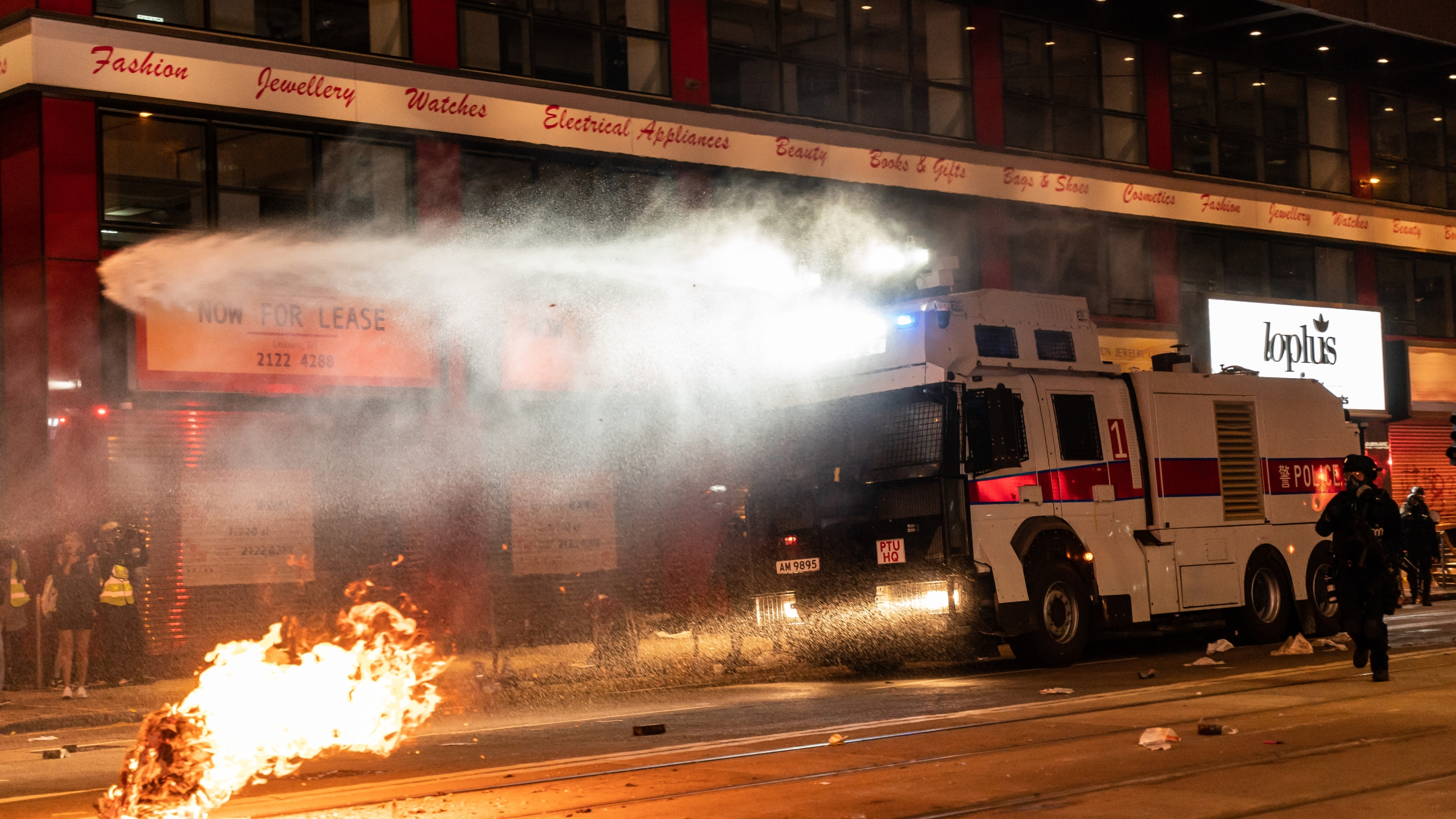 Police deploy a water canon vehicle to disperse protesters in Causeway Bay district during a rally on New Years Day on January 1, 2020, in Hong Kong. (Credit: Anthony Kwan/Getty Images)