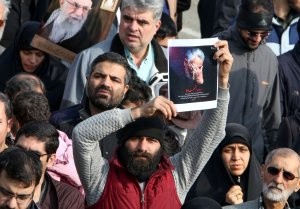 A man holds a picture of slain Iranian Revolutionary Guard Maj. Gen. Qasem Soleimani during a demonstration in Tehran on Jan. 3, 2020. (Credit: Atta Kenare / AFP / Getty Images)