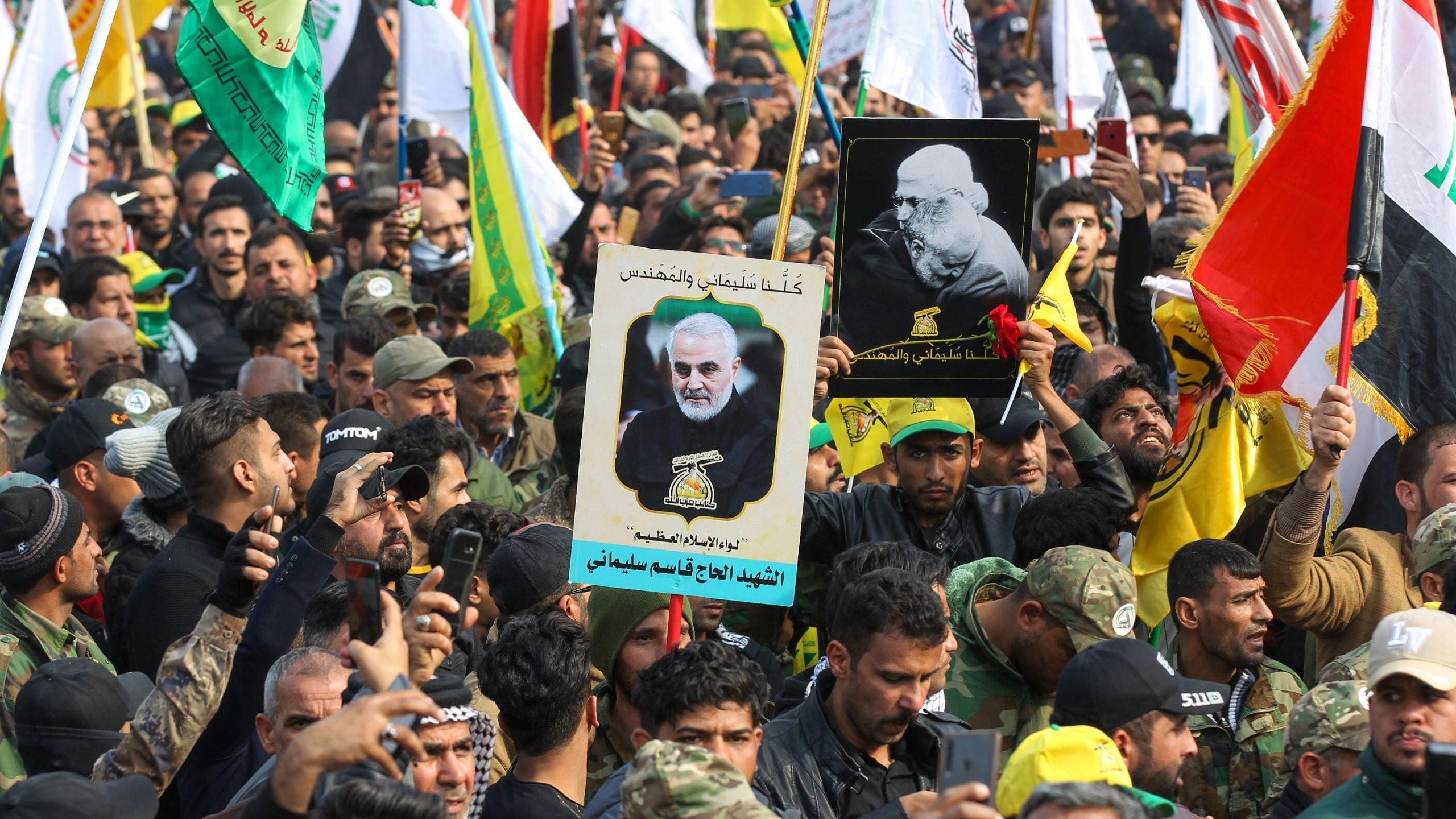 Supporters of the Hashed al-Shaabi paramilitary force and Iraq's Hezbollah brigades attend the funeral of Iranian military commander Qassem Soleimani in Baghdad's district of al-Jadriya on Jan. 4, 2020. (Credit: AHMAD AL-RUBAYE/AFP via Getty Images)