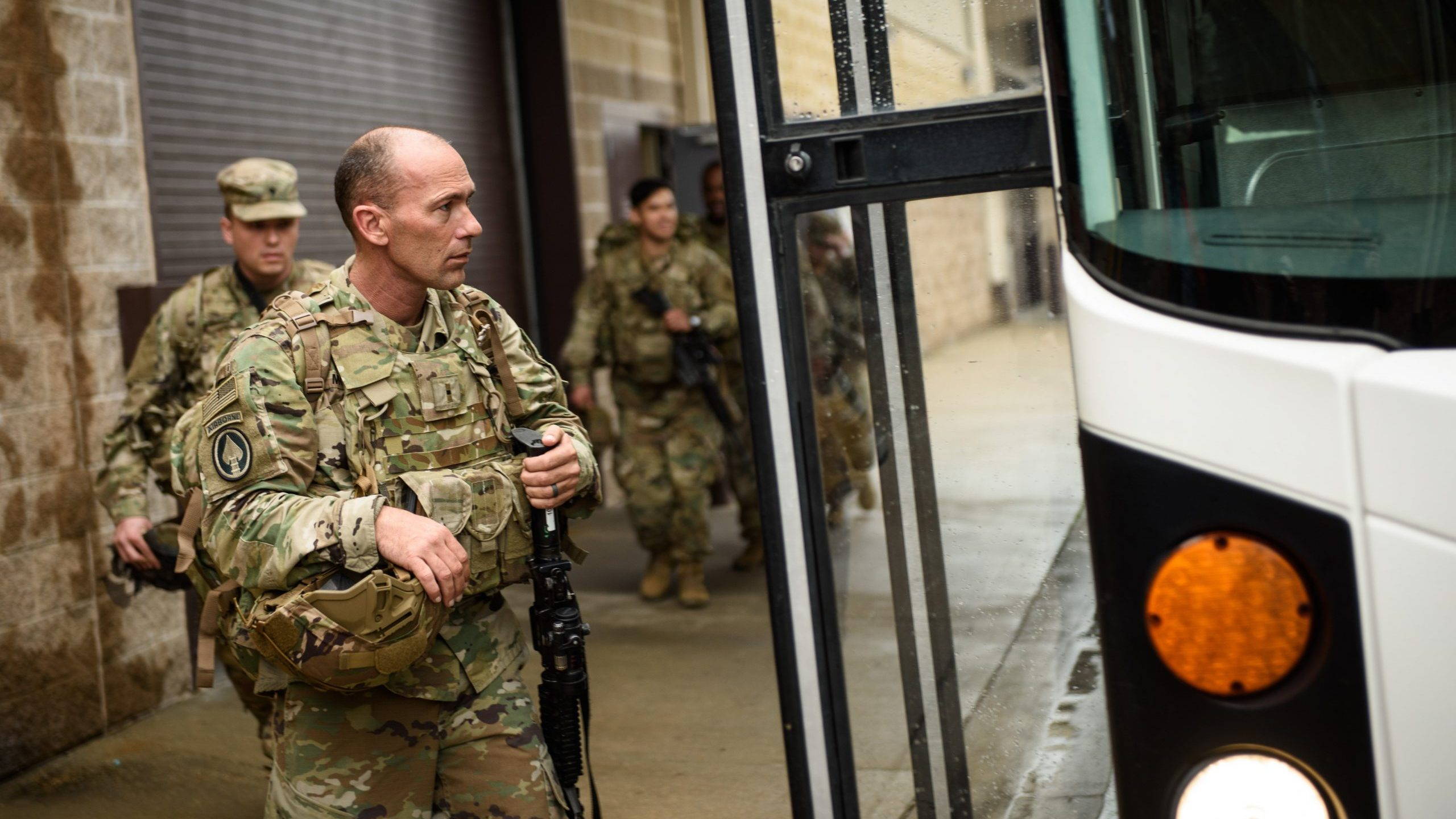 U.S. troops from the Army's 82nd Airborne Division board a bus as they head out for a deployment to the Middle East on Jan. 4, 2020 in Fort Bragg, North Carolina. (Credit: Andrew Craft/Getty Images)