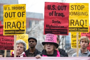 Demonstrator hold a signs during a protest against war in Iraq and Iran outside the White House on Jan. 4, 2020, in Washington, DC.(Credit: Alex Edelman/Getty Images)