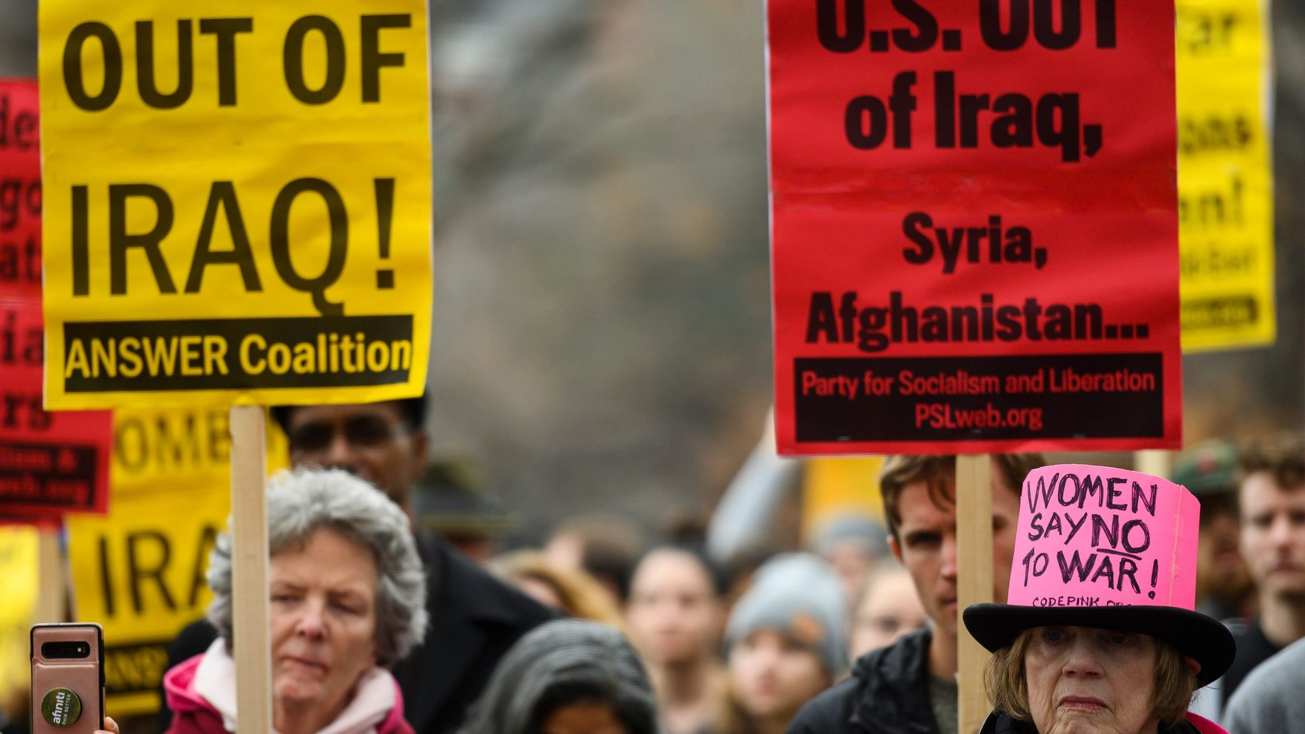 Anti-war activists march from the White House to the Trump International Hotel in Washington, DC, on Jan. 4, 2020. (Credit: Andrew Caballero-Reynolds / AFP / Getty Images)