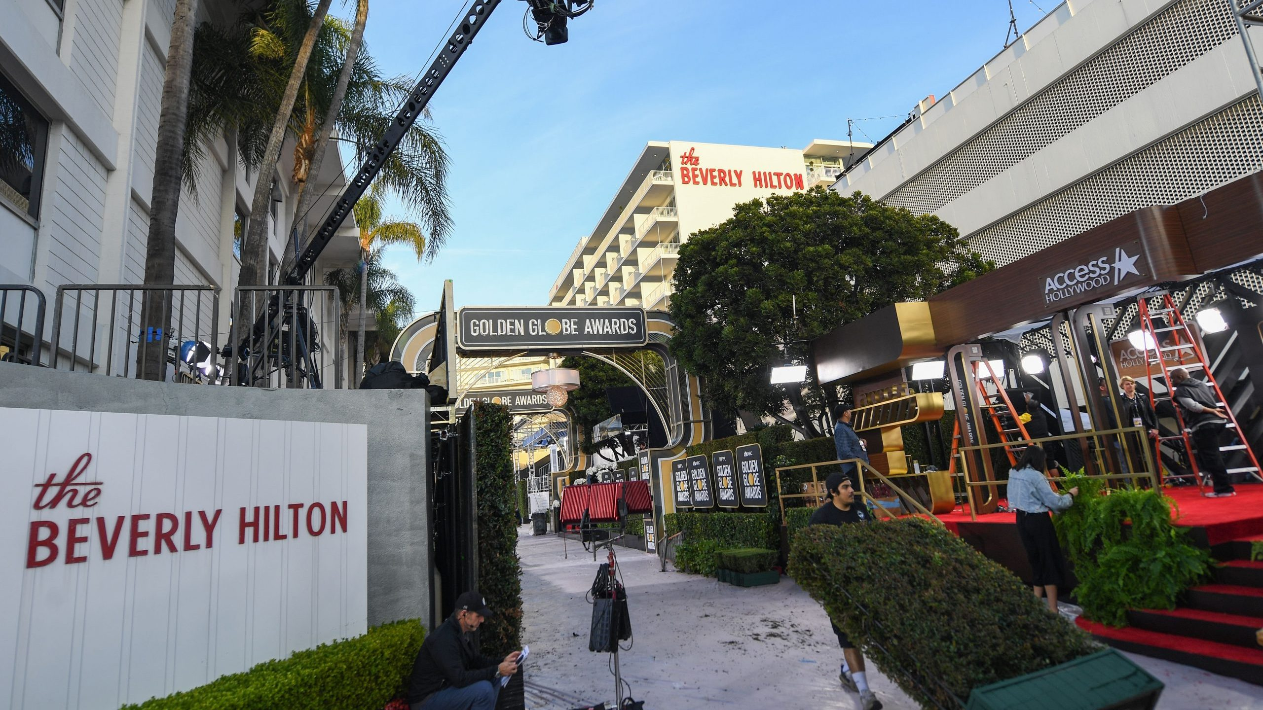 Crews set up the red carpet for the Golden Globes 2020 at The Beverly Hilton on Jan. 4, 2020. (Credit: VALERIE MACON/AFP via Getty Images)