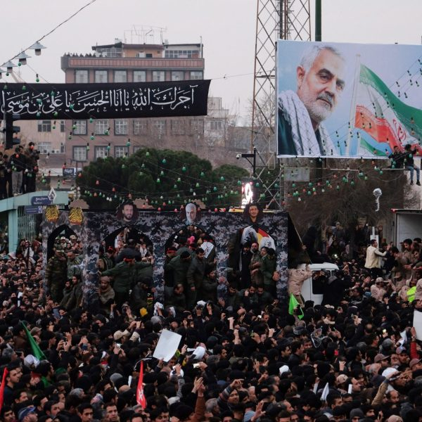 Iranians gather around a vehicle carrying the coffins of slain major general Qassem Soleimani and others, as they pay homage in the northeastern city of Mashhad on Jan. 5, 2020. (Credit: MEHDI JAHANGHIRI/IRAN'S FARS NEWS AGENCY/AFP via Getty Images)