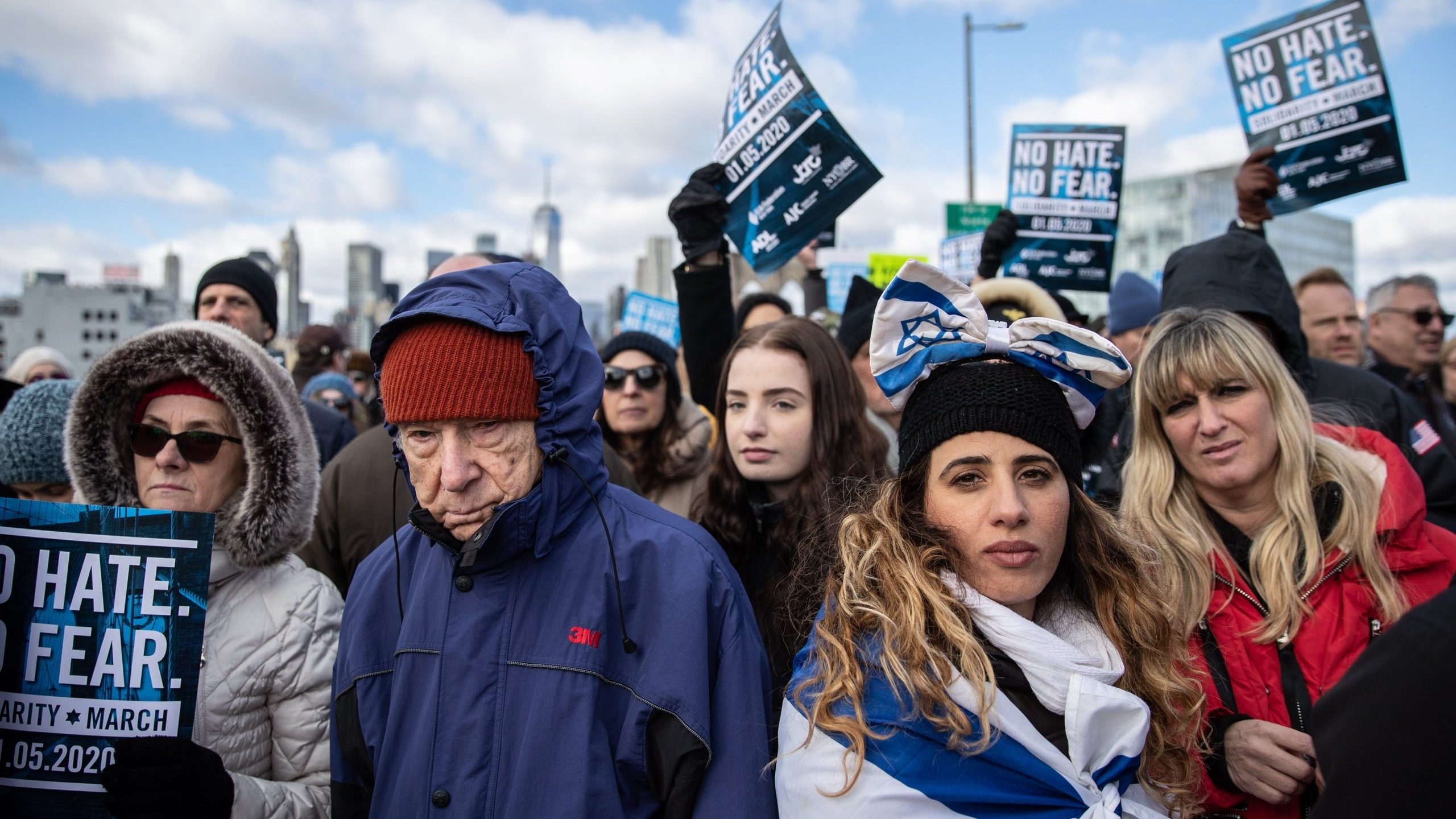 People participate in a Jewish solidarity march across the Brooklyn Bridge in New York City on Jan. 5, 2020. (Credit: Jeenah Moon / Getty Images)
