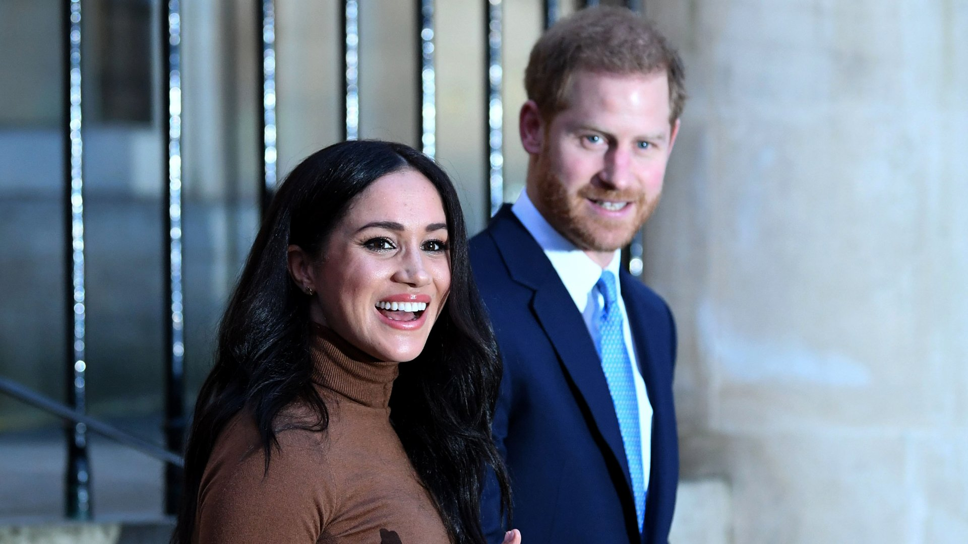 Prince Harry, Duke of Sussex and Meghan, Duchess of Sussex react after their visit to Canada House on Jan. 7, 2020 in London. (Credit: DANIEL LEAL-OLIVAS - WPA Pool/Getty Images)