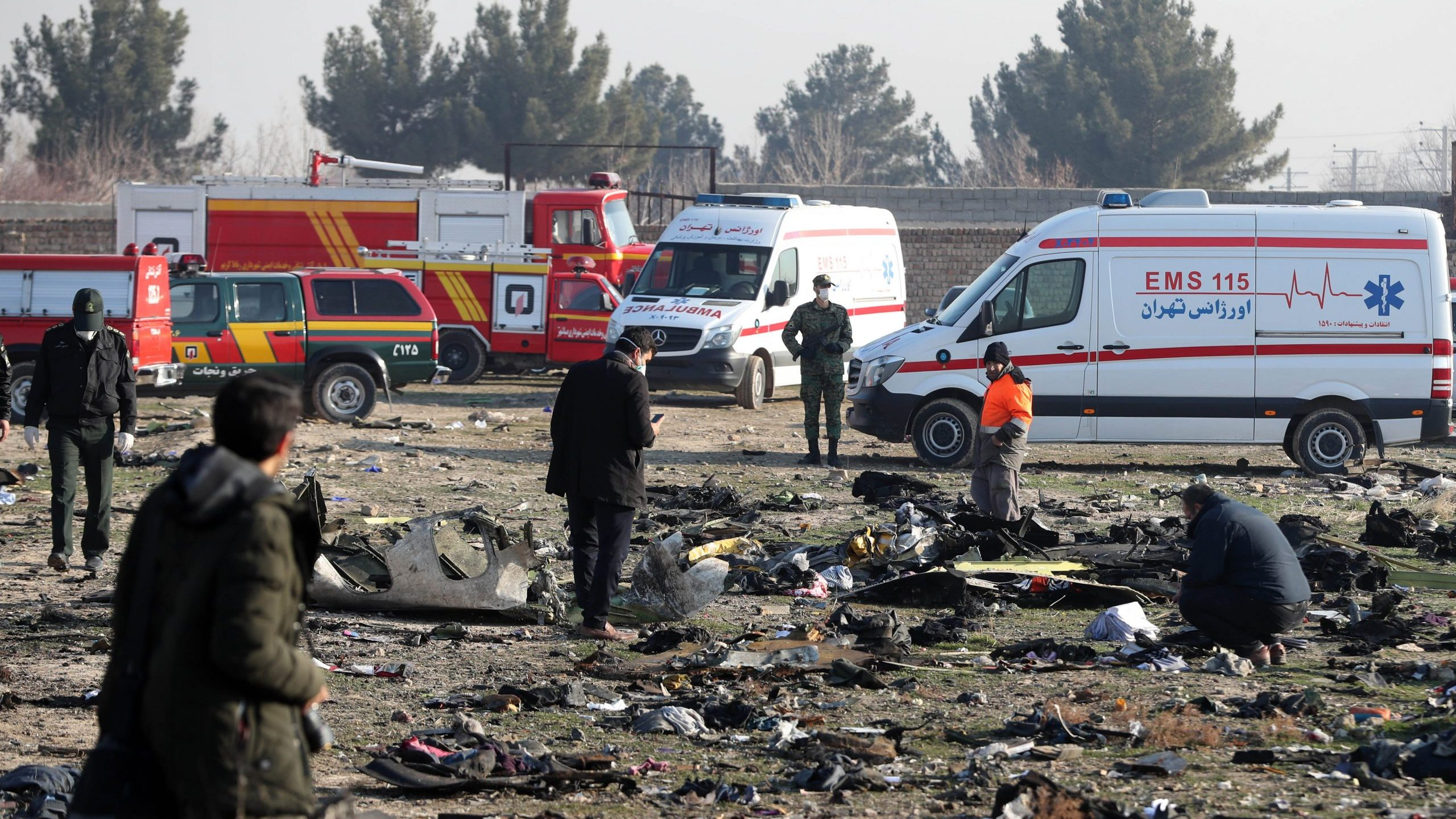 Rescue teams assess the wreckage after a Ukrainian plane carrying 176 passengers crashed near Imam Khomeini Airport in the Iranian capital Tehran early in the morning on Jan. 8, 2020. (Credit: AFP via Getty Images)