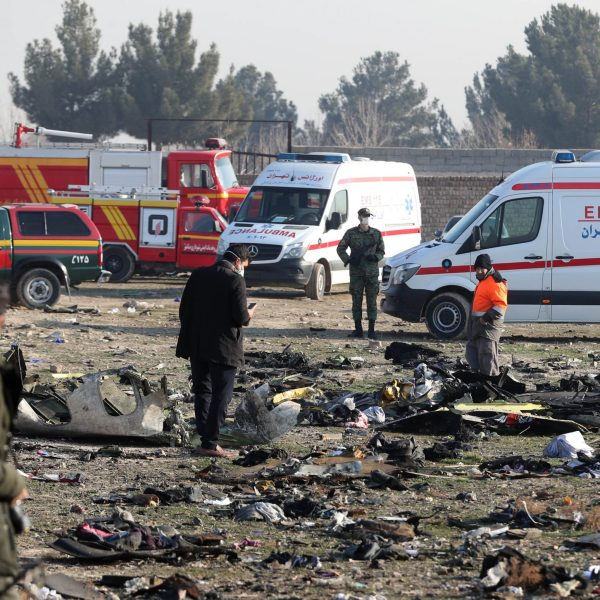 Rescue teams work amidst debris after a Ukrainian plane carrying 176 passengers crashed near Imam Khomeini airport in the Iranian capital Tehran early in the morning on January 8, 2020, killing everyone on board. (Credit: AFP via Getty Images)