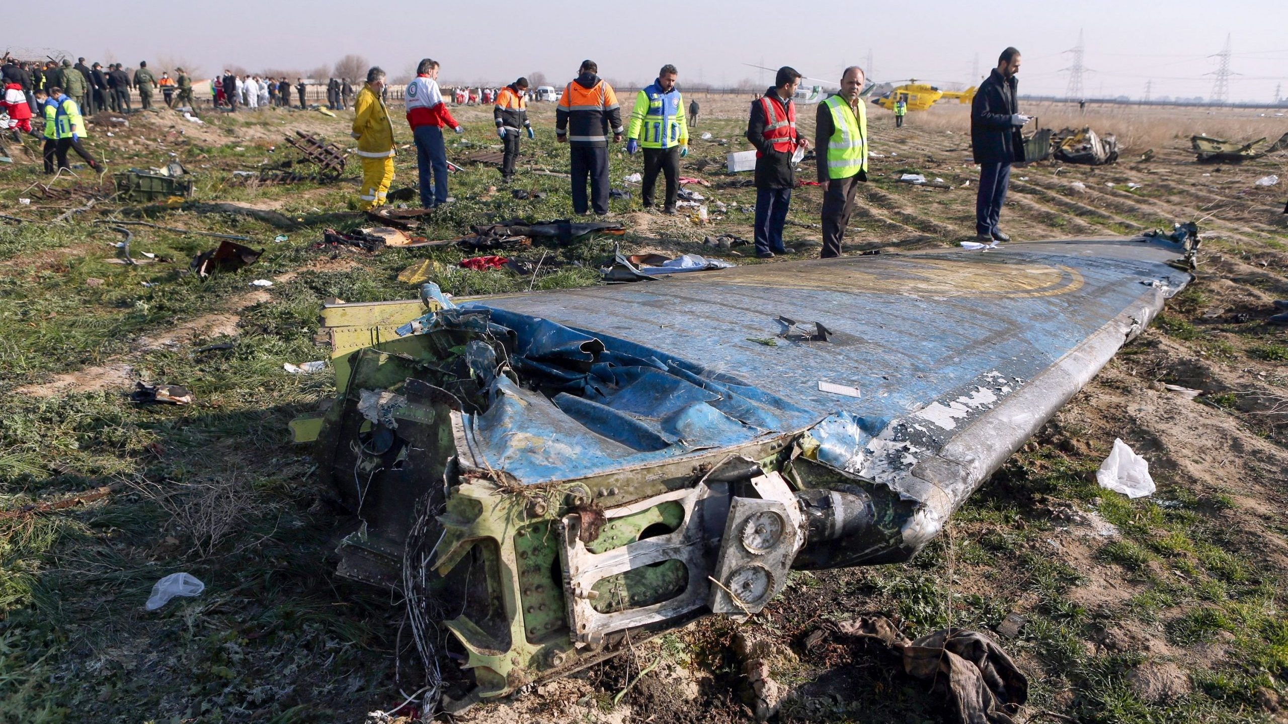 Rescue teams respond to the scene of a Ukrainian airliner that crashed shortly after takeoff from Imam Khomeini airport in the Iranian capital Tehran on Jan. 8, 2020. (Credit: Akbar Tavakoli / IRNA / AFP / Getty Images)