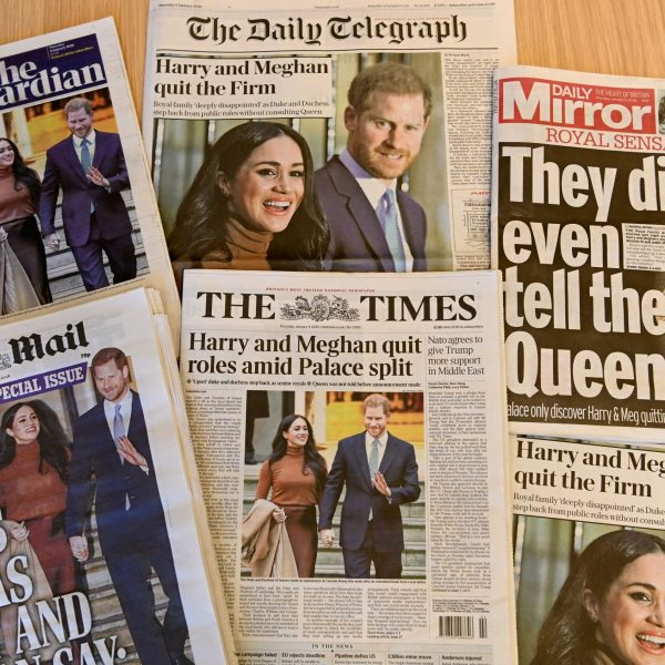 "An arrangement of UK daily newspapers photographed as an illustration in London on January 9, 2020, shows front page headlines reporting on the news that Britain's Prince Harry, Duke of Sussex and his wife Meghan, Duchess of Sussex, plan to step back as ""senior"" members of the Royal Family. (Credit: DANIEL LEAL-OLIVAS/AFP via Getty Images)"