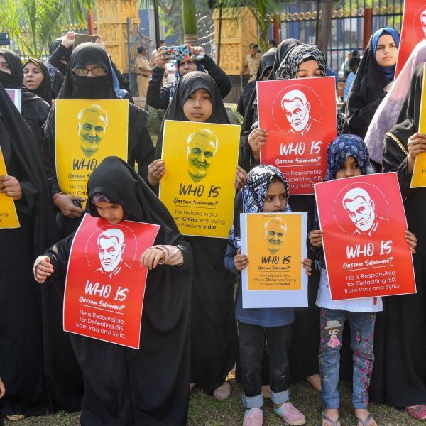 Demonstrators hold posters showing Iranian general Qassem Soleimani to protest against U.S. military action that killed the general in Iraq on Jan. 9, 2020, in Mumbai. (Credit: INDRANIL MUKHERJEE/AFP via Getty Images)