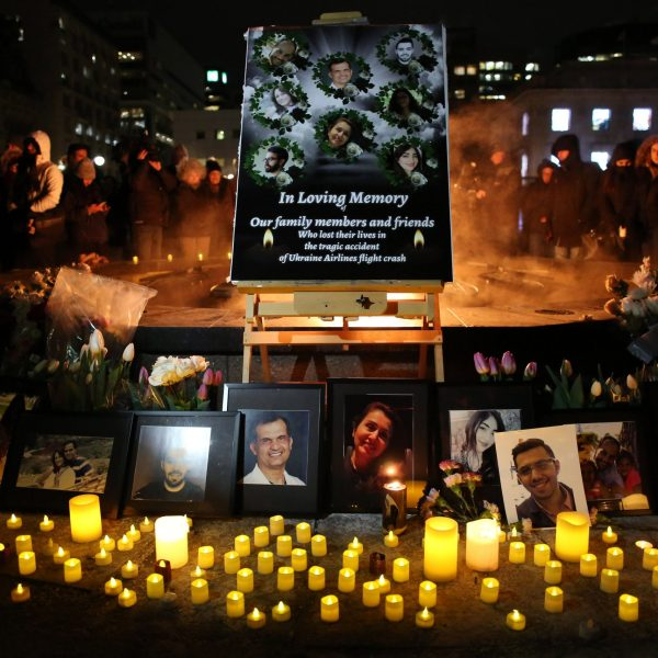 An altar with photographs of the victims who were killed in a plane crash in Iran is seen as people gather around to held a vigil in their memories on January 09, 2020 in Ottawa, Canada. (Credit: Dave Chan/Getty Images)