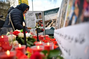 Demonstrators from the Anglo-Iranian Communities in the U.K. attend a vigil opposite the gates of 10 Downing Street in central London on Jan.10, 2020, for the victims of the Ukrainian airliner that crashed on Jan. 8, killing all 176 onboard. (Credit: BEN STANSALL/AFP via Getty Images)