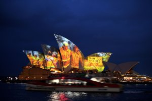 The sails of the Opera House are lit with a series of images to show support for the communities affected by the bushfires and to express the gratitude to the emergency services and volunteers in Sydney on Jan. 11, 2020. (Credit: SAEED KHAN/AFP via Getty Images)