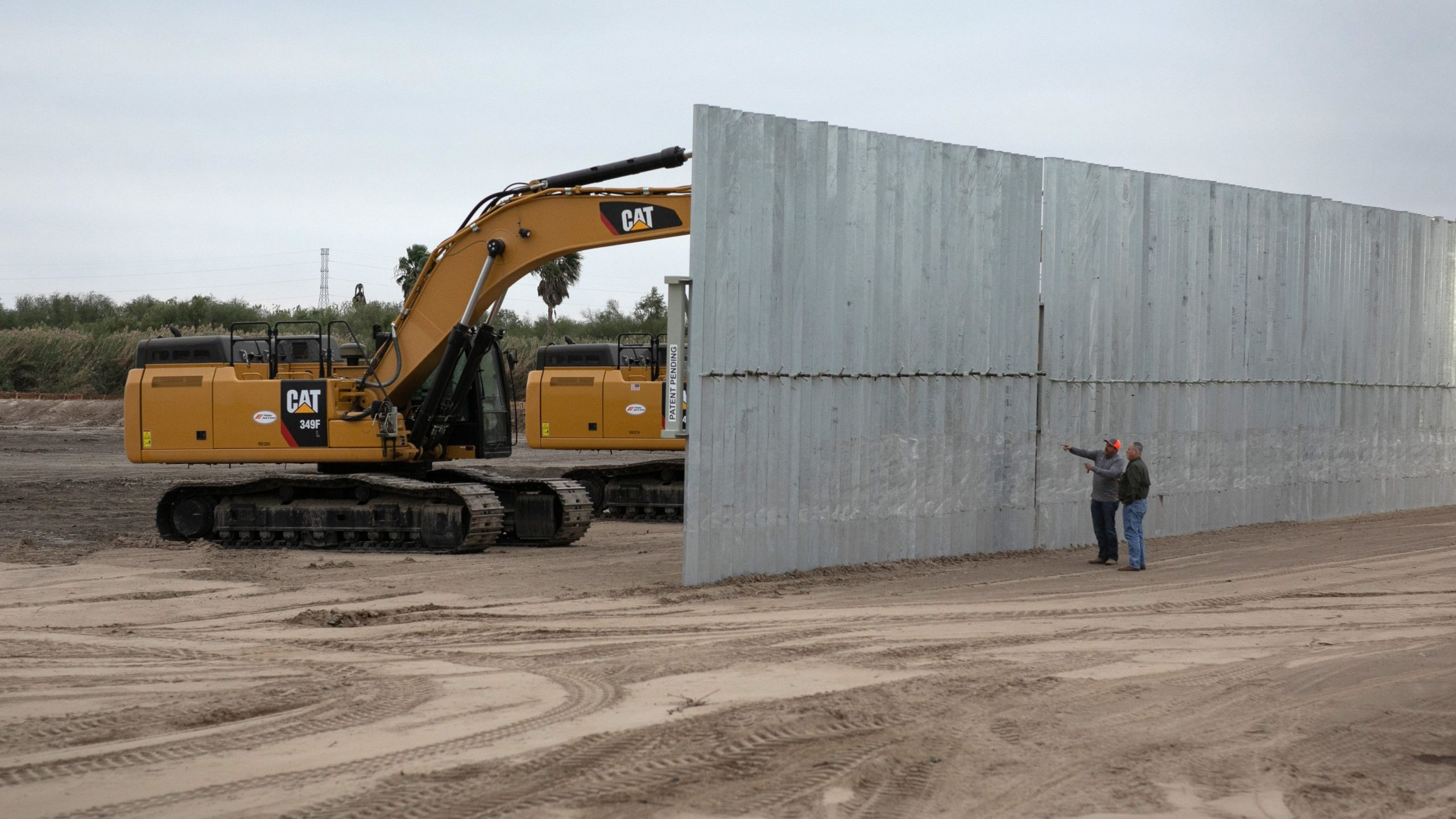 A construction crew works on a section of privately funded border wall on Dec. 11, 2019, near Mission, Texas. (Credit: John Moore / Getty Images)