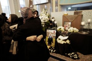 Mourners gather at the Imam Mahdi Islamic Centre in Toronto, Ontario on Jan. 12, 2020 to mourn Sahar Haghjoo and her 9-year-old daughter Elsa Jadidi, who were among the passengers of Ukrainian Airlines flight 752, which was shot down over Iran. (Credit: GEOFF ROBINS/AFP via Getty Images)