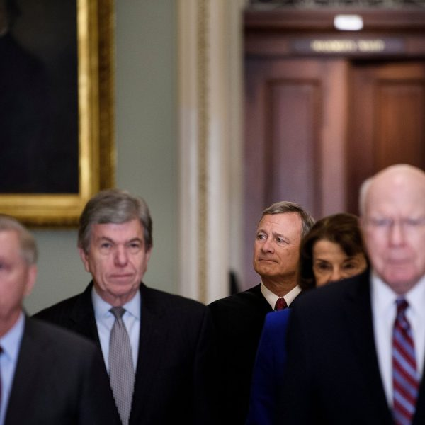 Supreme Court Justice John Roberts (center rear) is escorted to the US Senate Chamber by Senators Lindsey Graham (left), Roy Blunt (2nd left) and Patrick Leahy at the U.S. Capitol in Washington, D.C., on Jan 16, 2020. (Credit: BRENDAN SMIALOWSKI/AFP via Getty Images)