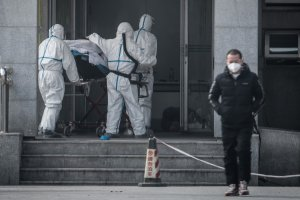 Medical staff members carry a patient into the Jinyintan hospital, where patients infected by a mysterious virus are being treated, in Wuhan in China's central Hubei province on Jan. 18, 2020. (Credit: STR/AFP via Getty Images)