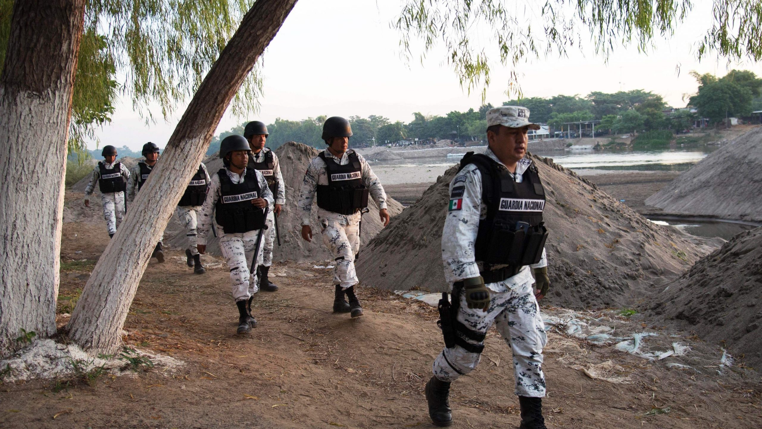 Members of the Mexican National Guard patrol along the banks of the Suchiate River in Ciudad Hidalgo, Chiapas State, Mexico, on Jan. 18, 2020. (Credit: ISAAC GUZMAN/AFP via Getty Images)