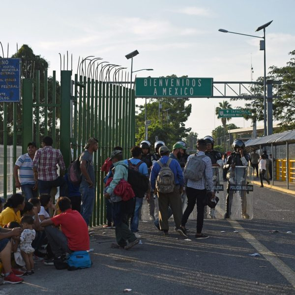 Honduran migrants wait to cross the international border bridge from Ciudad Tecun Uman in Guatemala to Ciudad Hidalgo in Mexico, on Jan. 18, 2020. (Credit: JOHAN ORDONEZ/AFP via Getty Images)