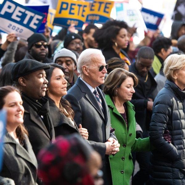 Democratic presidential candidates, Rep. Tulsi Gabbard (D-HI), left, former Vice President Joe Biden, Sen. Amy Klobuchar (D-MN), Sen. Elizabeth Warren (D-MA), and Sen. Bernie Sanders (I-VT), right, march to the King Day event on Jan. 20, 2020, in Columbia, South Carolina. (Credit: Sean Rayford/Getty Images)