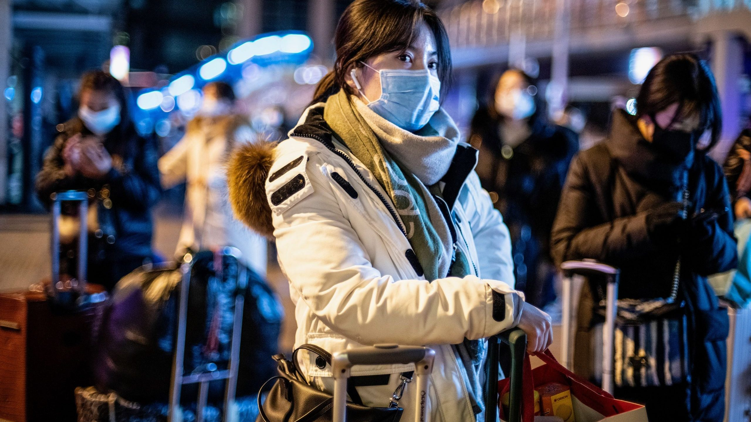A woman wearing a protective mask looks on as she arrives at Beijing railway station ahead of the Lunar New Year in Beijing on Jan. 23, 2020. (Cerdit: NOEL CELIS/AFP via Getty Images)