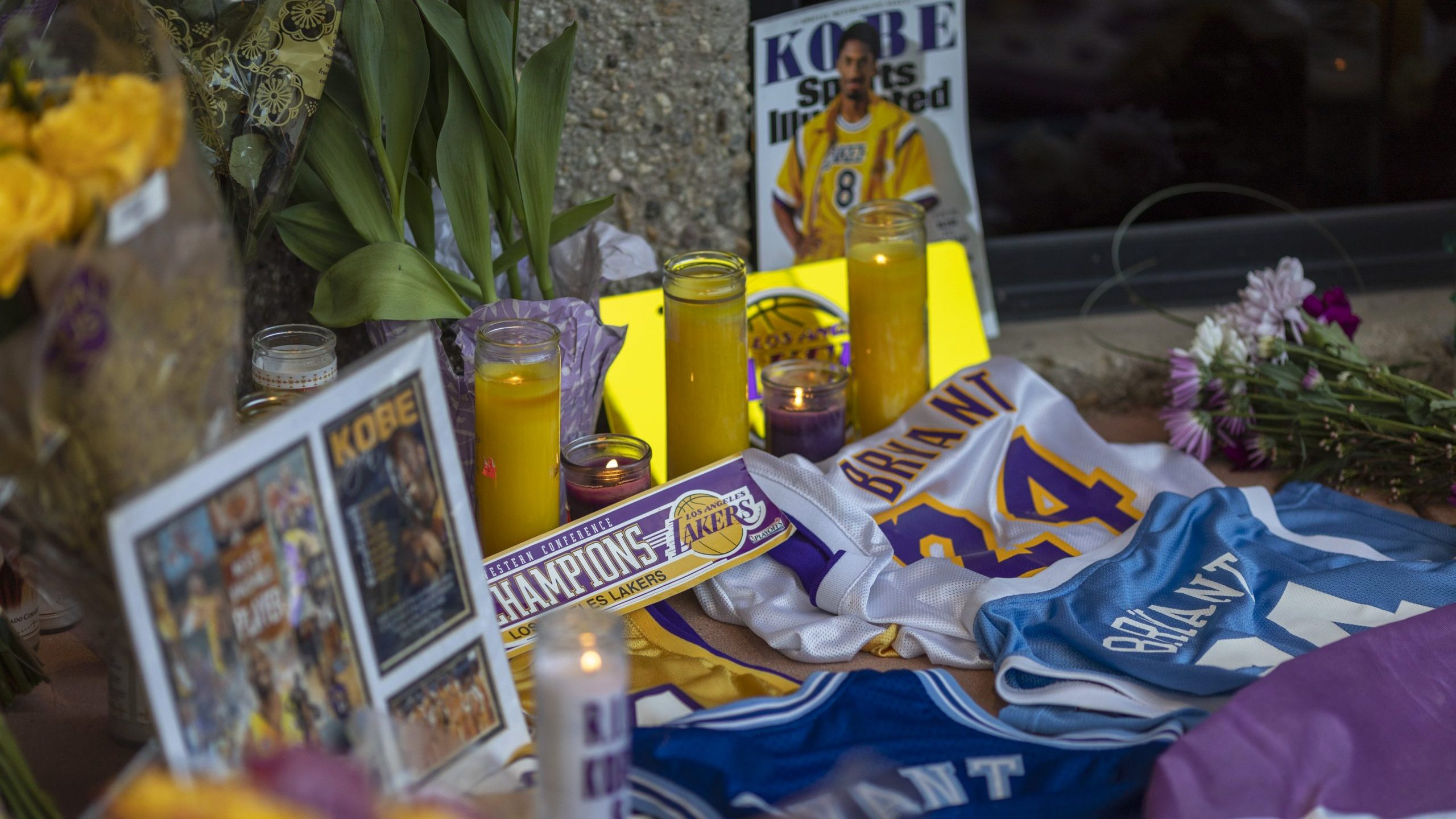 People mourn at a makeshift memorial at Mamba Sports Academy for former NBA great Kobe Bryant, who was killed in a helicopter crash while commuting to the academy on January 26, 2020 in Newbury Park, California. (Credit: David McNew/Getty Images)