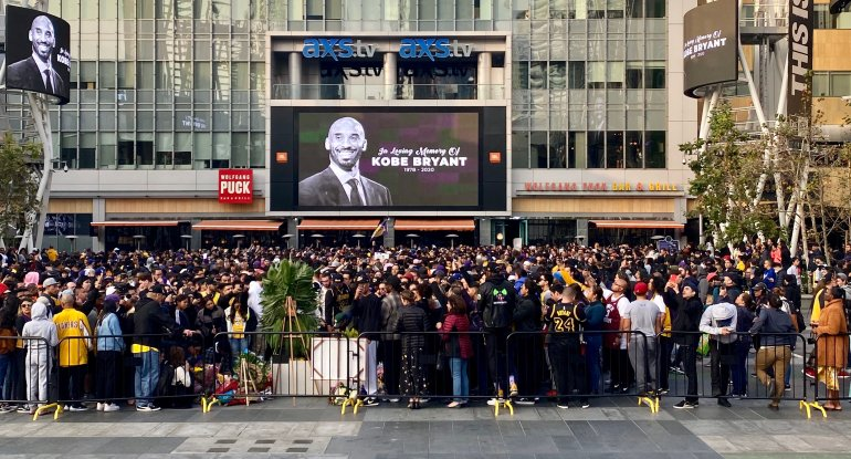 People gather around a makeshift memorial for Kobe Bryant at L.A. Live Plaza in front of Staples Center on Jan. 26, 2020.(Credit: AGUSTIN PAULLIER/AFP via Getty Images)