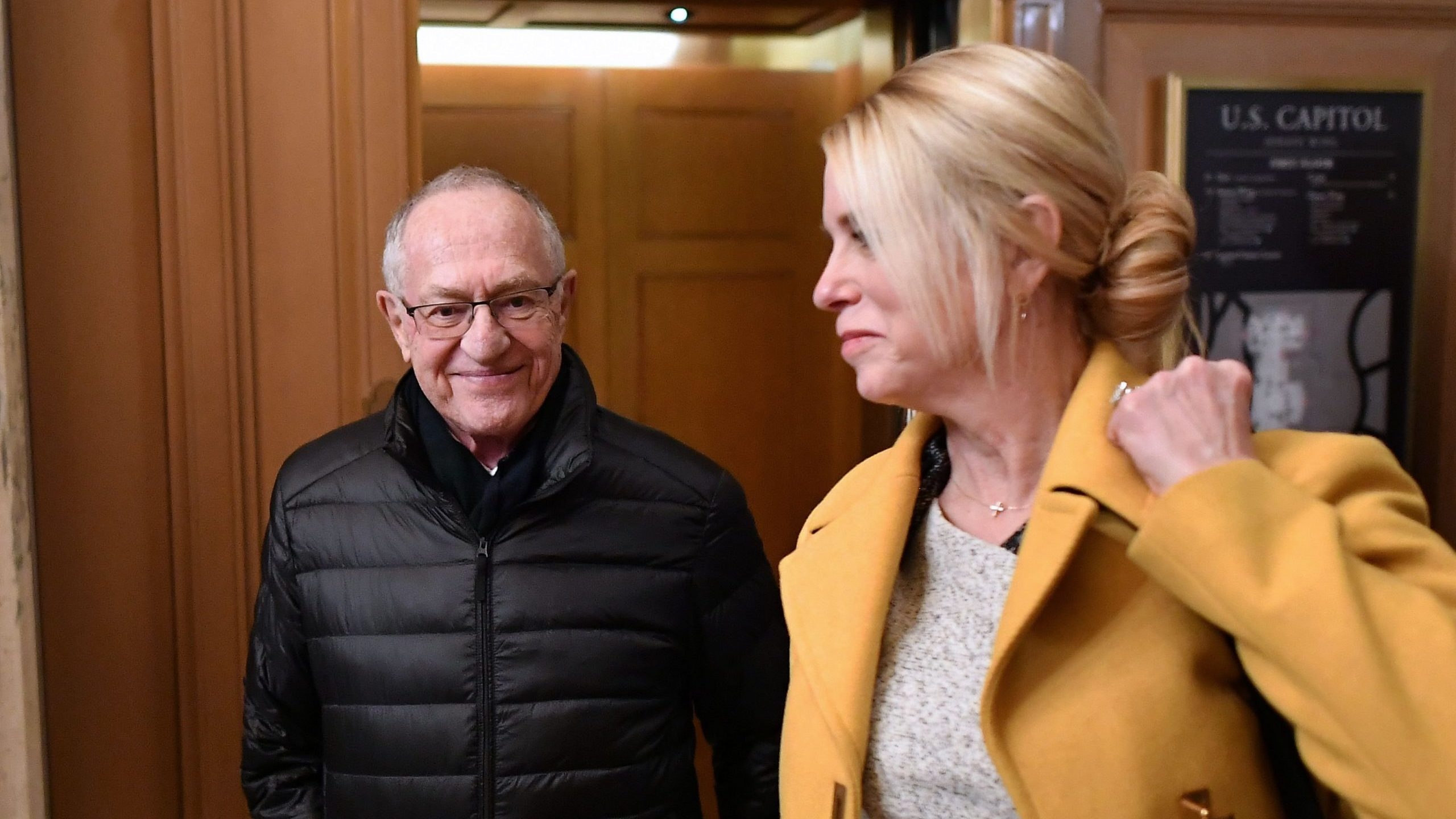 US President Donald Trump lawyers Alan Dershowitz (L) and Pam Bondi depart the Senate chamber after the impeachment trial of US President Donald Trump at the US Capitol in Washington, DC on January 27, 2020. (Credit: MANDEL NGAN/AFP via Getty Images)