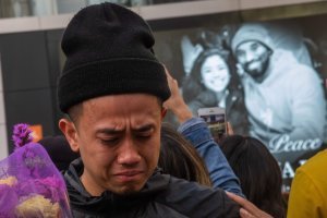 A man cries in front of a makeshift memorial for Kobe Bryant and his daughter Gianna in front of the Staples Center on Jan. 27, 2020. (Credit: Apu Gomes / AFP / Getty Images)