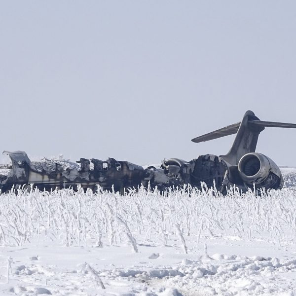 The wreckage of a US Bombardier E-11A jet is seen after it crashed in a mountainous territory of Deh Yak district in Ghazni Province if Afghanistan on Jan. 28, 2020. (Credit: STR/AFP via Getty Images)