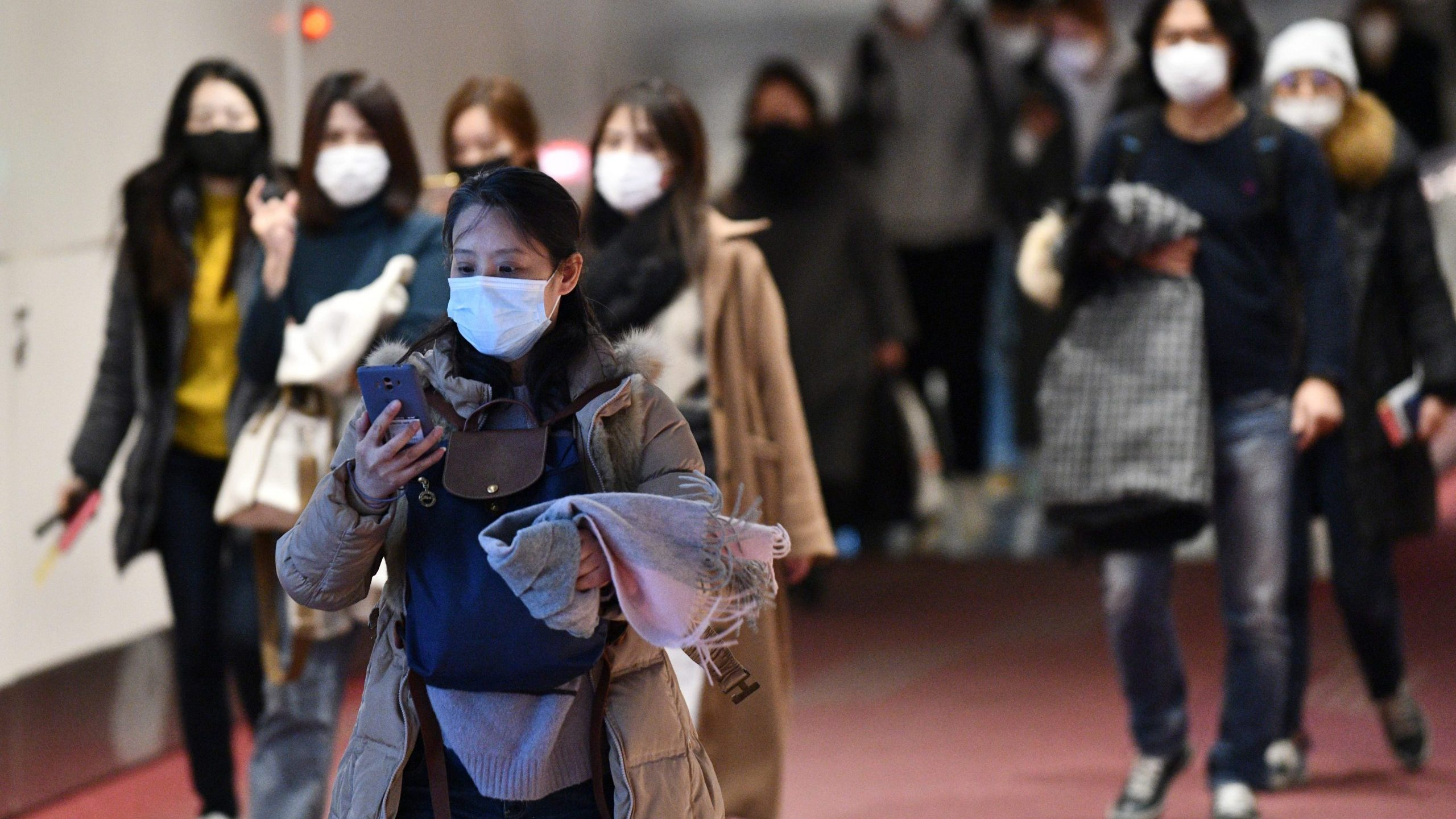 Passengers from overseas arrive at Tokyo's Haneda International Airport on Jan. 28, 2020, after Japan sent a plane to Wuhan to evacuate citizens from the epicenter of the deadly virus outbreak.(Credit: KAZUHIRO NOGI/AFP via Getty Images)