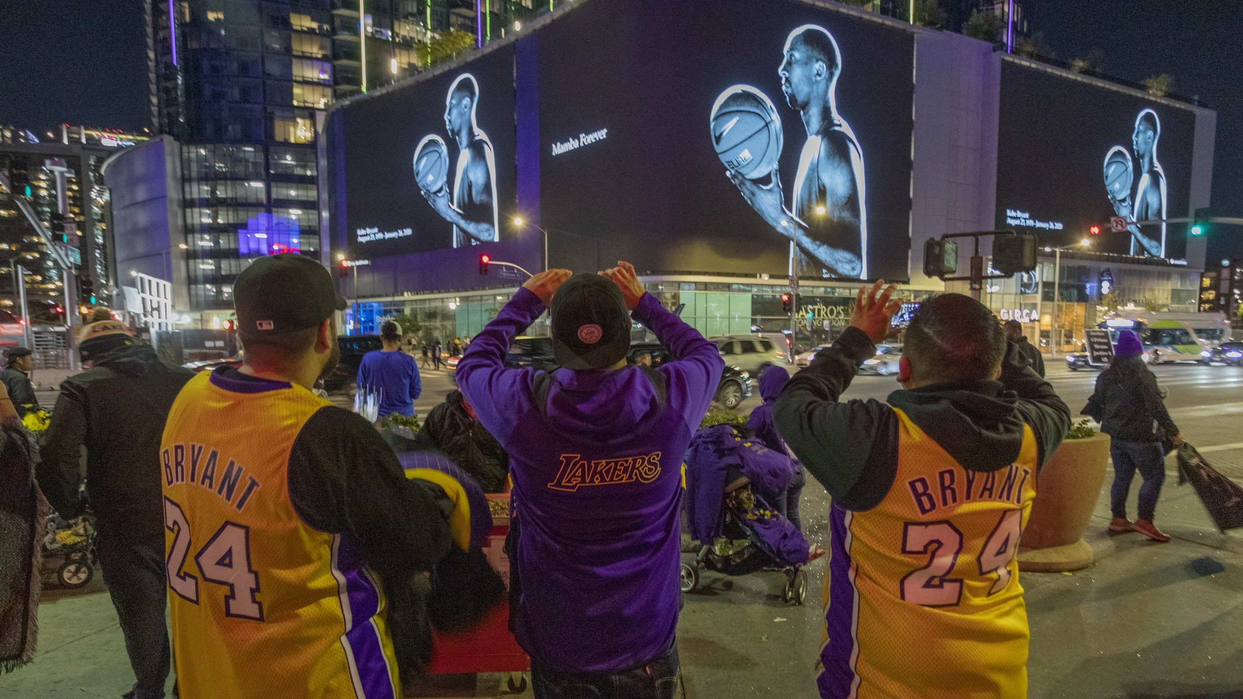 """On Jan. 28, 2020, signs in downtown Los Angeles memorialize NBA great Kobe Bryant, who along with his 13-year-old daughter, Gianna, died in a helicopter crash two days earlier. Kobe and """"Gigi"""" were among nine killed in the crash in Calabasas. (Credit: David McNew/Getty Images)"""