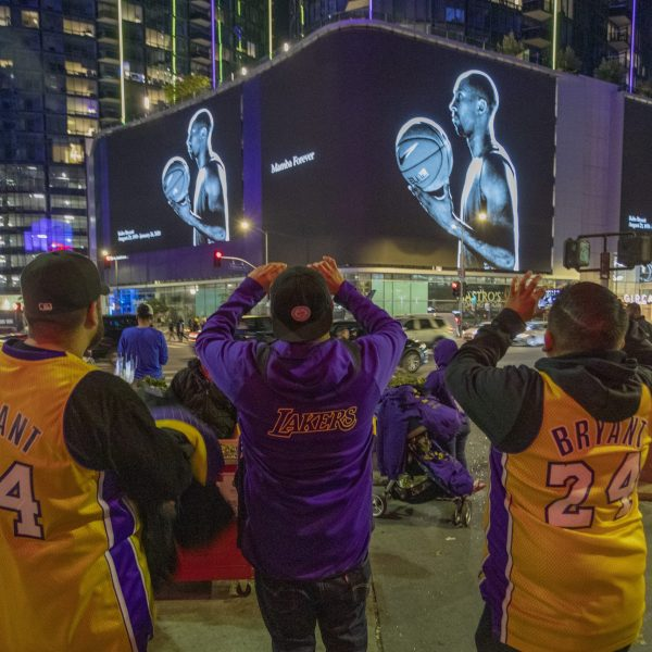 "On Jan. 28, 2020, signs in downtown Los Angeles memorialize NBA great Kobe Bryant, who along with his 13-year-old daughter, Gianna, died in a helicopter crash two days earlier. Kobe and ""Gigi"" were among nine killed in the crash in Calabasas. (Credit: David McNew/Getty Images)"