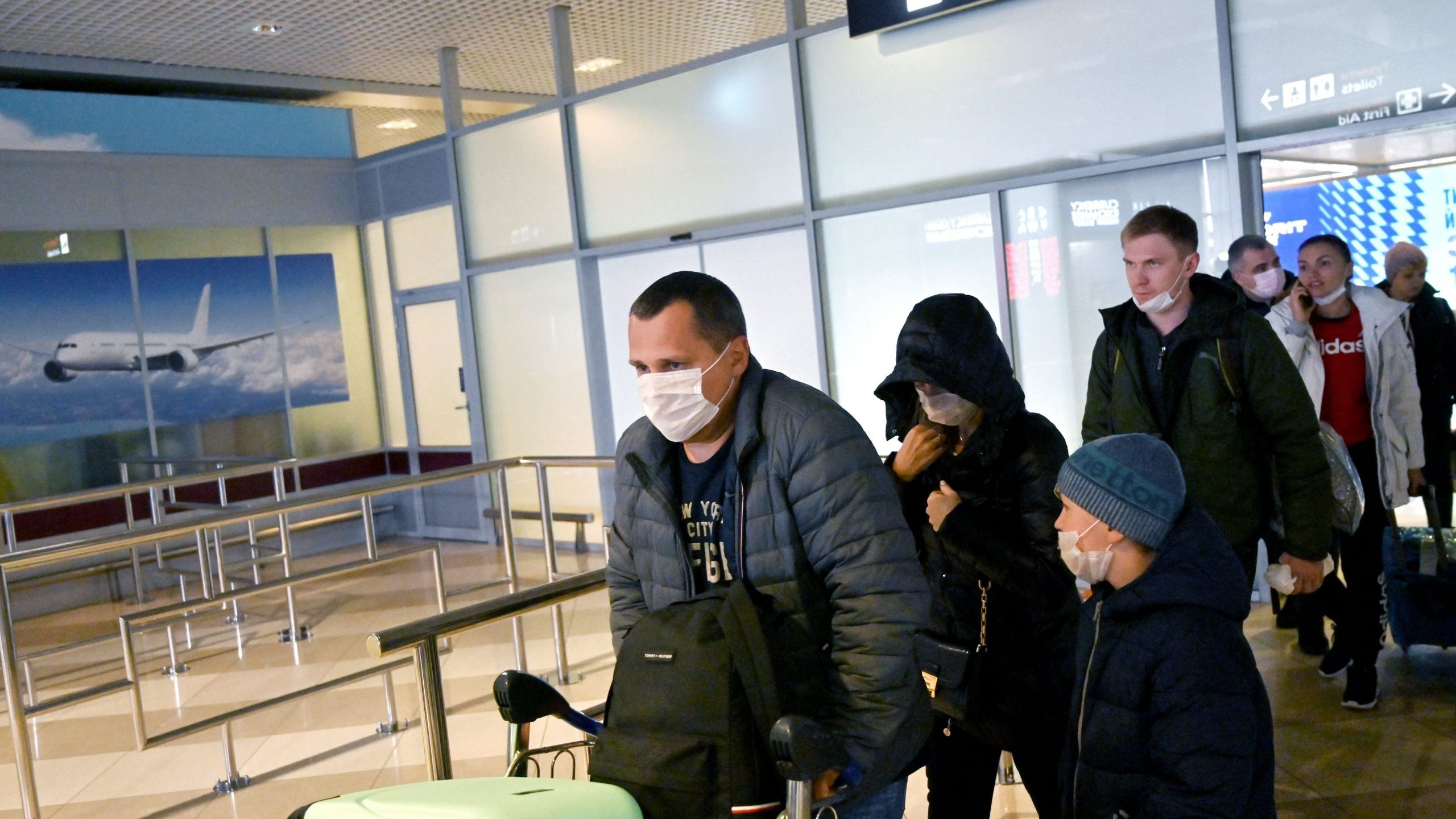 Ukrainian tourists walk in the arrival hall of the Internatioanal Boryspil airport outside Kiev after their plane landed from China on Jan. 30, 2020. The first out of four special flights will be held on Jan. 30, 2020, in order to evacuate hundreds of Ukrainian tourists from China as the deadly coronavirus outbreak grows. (Credit: SERGEI SUPINSKY/AFP via Getty Images)
