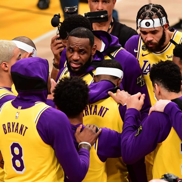 LeBron James, center, speaks with his Lakers teammates as they wear jerseys with NBA legend Kobe Bryant's numbers before their first game after Bryant's death at the Staples Center on Jan. 31, 2020. (Credit: Frederic J. Brown / AFP / Getty Images)